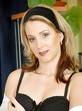 Hot brunette milf Janine flaunts her irresistible cougar frame in sheer black lingerie
