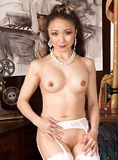 Naughty Asian mommy spreads open her silky smooth pussy