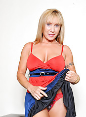 Wow cleavage that makes you drool and firm legs draw you in to this elegant blonde cougar named Luna