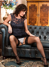 Sexy housewife gives a peek up her dress and between her legs