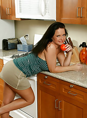Classy housewife in a short skirt flaunts her scrumptious body in the kitchen