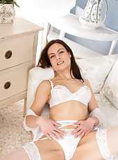 Gorgeous mommy looks angelic in her see through white lingerie