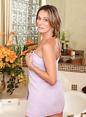 Milf Misty Law seduces us with her nearly nude body wrapped in a towel