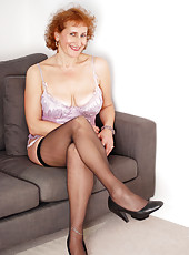 Classy Anilos beauty posing in her soft silky lingerie and stockings