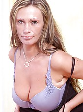 Sultry cougar pandora shows off her mouth watering cleavage in a violet bra and panty set