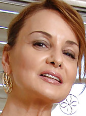 Hot cougar Rebecca Bardoux hikes up her dress exposing her round ass in a sexy thong