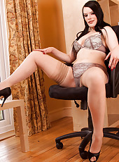 Checkout Rebekka Raynor showing off her tempting cleavage as she undresses herself during an office break