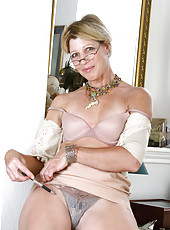 Hot mature secretary peels off her clothes to reveal her bra and panties
