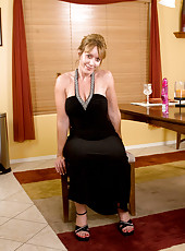 Lovely lady teases us with her alluring black evening dress