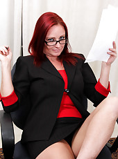 Ultra hot cougar wears professional attire and gives an upskirt peek