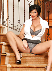 Short haired milf in her office wear shows off sexy undies on stairs