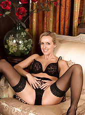 Sexy milf wears mouthwatering lingerie and stockings
