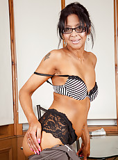 Teacher in glasses getting frisky in her bra and stockings