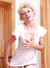 Horny cougar Susan Lee is ready to strip off her sexy black bra and panties