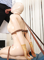 Latex Lucy tied up to a table