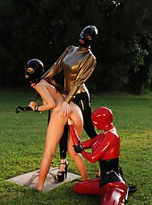 Two dominatrixes and naked slave