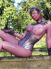 Latex Lucy In A Purple Body Suit