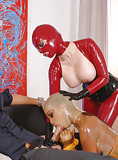 Ladies In Latex In Kinky Threesome