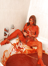 Chained Zuzana Z peeing in juice