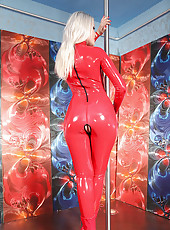 Blond Monique pole dancing in latex