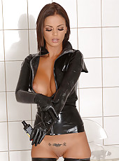 Sexy Black Angelica toying in latex