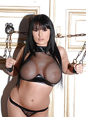 Busty babe Alison peeing in chains