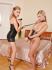 Hot blonde babes spanking in latex
