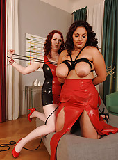 Busty latex lesbos having kinky fun
