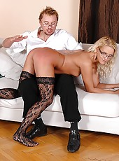 Horny blonde spanked on the sofa