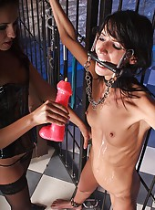 Girl tied & covered with candle wax