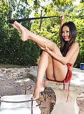 Exotic babe Danika soloing outdoors