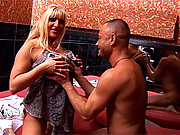 Slutty busty blonde mature hooker stroking an Italian cock