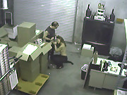 Two co-workers are caught on a hidden security cam having sex