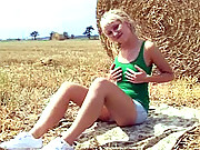 Blonde teenage farmer girl toying pussy outside the barn