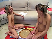 Two perky girlfriends playing with their fresh teen pussies