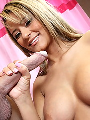 Naughty chick Jodi Bean plays with a massive dick with her hands