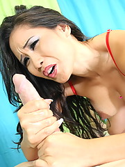 Jessica Bangkok gives a nice handjob while she licks his balls