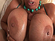 Dude sprays her monster tits down with hot cum