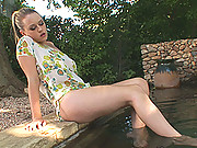 Busty Brookie G posing her sexy legs & feet naked at pool