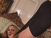 Sexy Julia Crown shows off in her black stockings and heels