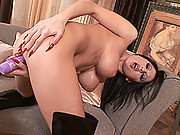Busty black-haired slut Alison plays with her huge vibrator