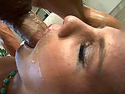 Blonde slut face covered in cum after deepthroating.