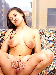 Busty young schoolgirl showing her fine natural boobies