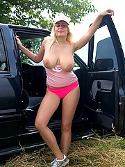 Blonde cutie with huge natural  tits toys pussy outdoor