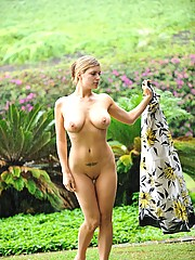 Danielle gets naked and naughty in the rain