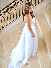 Danielle poses in a long white gown