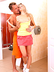 Cute blonde fucked while holding a lollipop in the shower