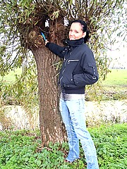 Dutch brunette girl toying her tight pussy in the nature