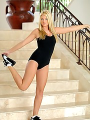 Alison Angel plays in her black tights