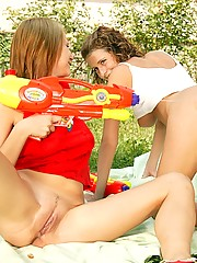 Two soaking lesbian teenagers abusing their water pistols